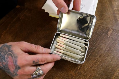 A clerk packs pre-rolled marijuana joints for a customer at the Medicinal Cannabis Dispensary, an un...