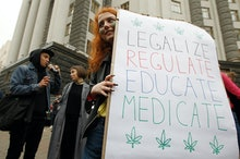 A participant holds a placard during the march. Participants of the rally advocate the legalisation ...