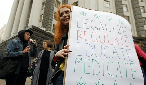 A participant holds a placard during the march. Participants of the rally advocate the legalisation of medical marijuana in Ukraine, cannabis smoking, and the decriminalisation of minor offences related to cannabis storage without the purpose of marketing.