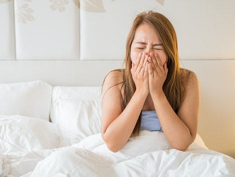 Asia woman are sick on the bed just a wake up on morning time,