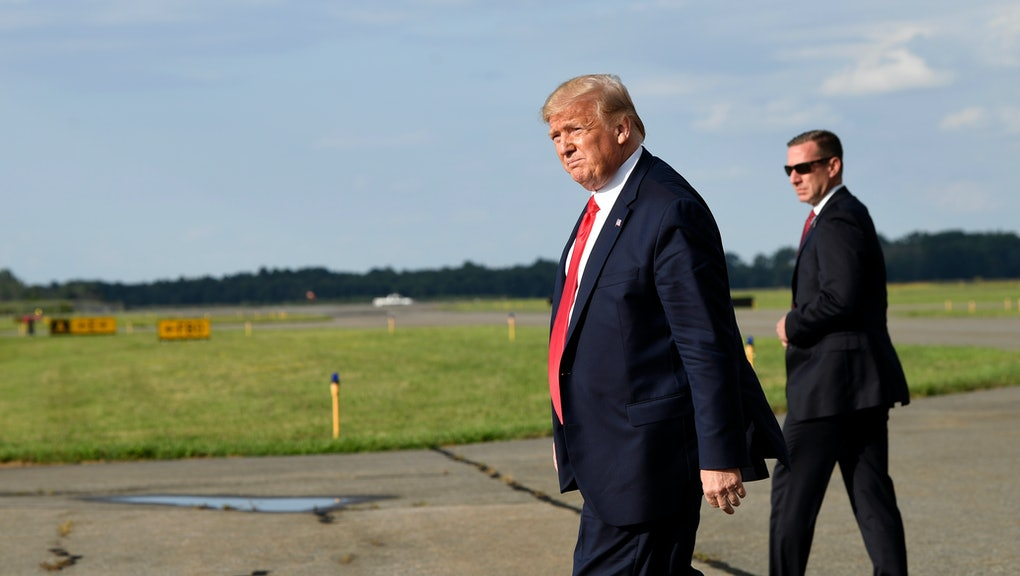 President Donald Trump walks towards Marine One at Morristown Municipal Airport in Morristown, N.J., to take the short trip to his golf club where he will be vacationing for a week