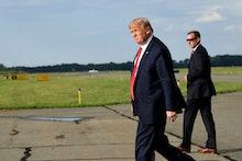 President Donald Trump walks towards Marine One at Morristown Municipal Airport in Morristown, N.J.,...