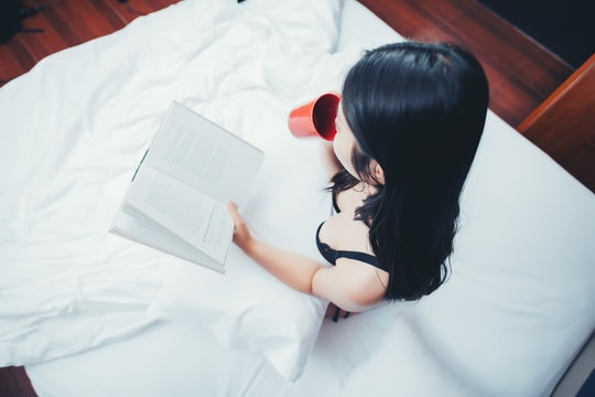 how to get turned on quickly; Woman reading book in bed