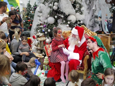 Children wait for their turn to the Santa gift moment while attending a Christmas Tree show dedicated to the children of the fallen or wounded soldiers of the Romanian Army, who died or got injured while serving in Afghanistan and Iraq, in Bucharest, Romania, 14 December 2018. The children could play in different playground areas before receiving their Christmas gifts. The event was organized by the Ministry of Defense in collaboration with the charity association of the Romanian Armed Forces named 'Comrades'.