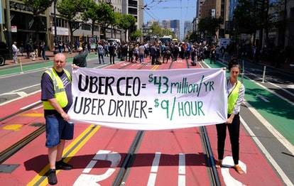 Protesters stop traffic on Market Street during a demonstration outside of Uber headquarters, in San...