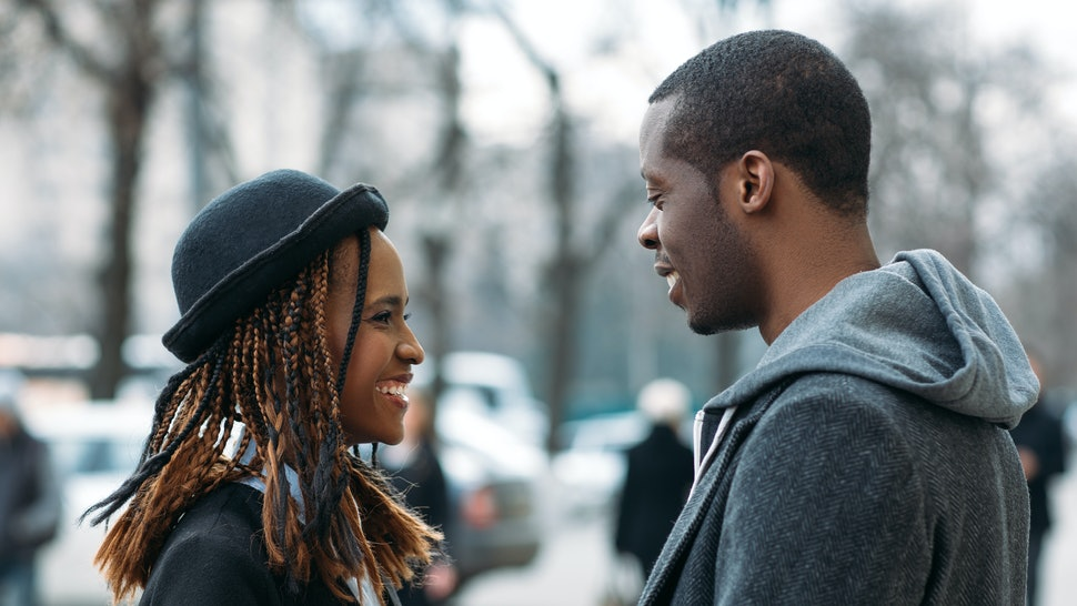 Happy young couple. Good news for black male. Joyful African American first date, stylish people on street, happiness and communication concept