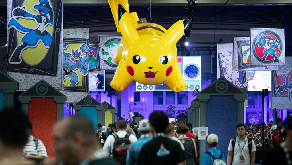 An inflated 'Pikachu' hangs over a crowd attending the 2019 Pokemon World Championships in Washington, DC, USA, 16 August 2019. Thousands of people are expected to attend the 2019 Pokemon World Championships that are taking place in Washington, DC, 16-18 August. Pokemon is the highest grossing franchise of all time. According to 2018 figures, Pokemon's nearly 50 billion USD of retail sales combined with the mobile presence 'Pokemon Go' makes it the top-grossing media franchise, beating second-place 'Star Wars' by over sixteen billion dollars.