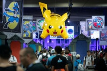 An inflated 'Pikachu' hangs over a crowd attending the 2019 Pokemon World Championships in Washingto...