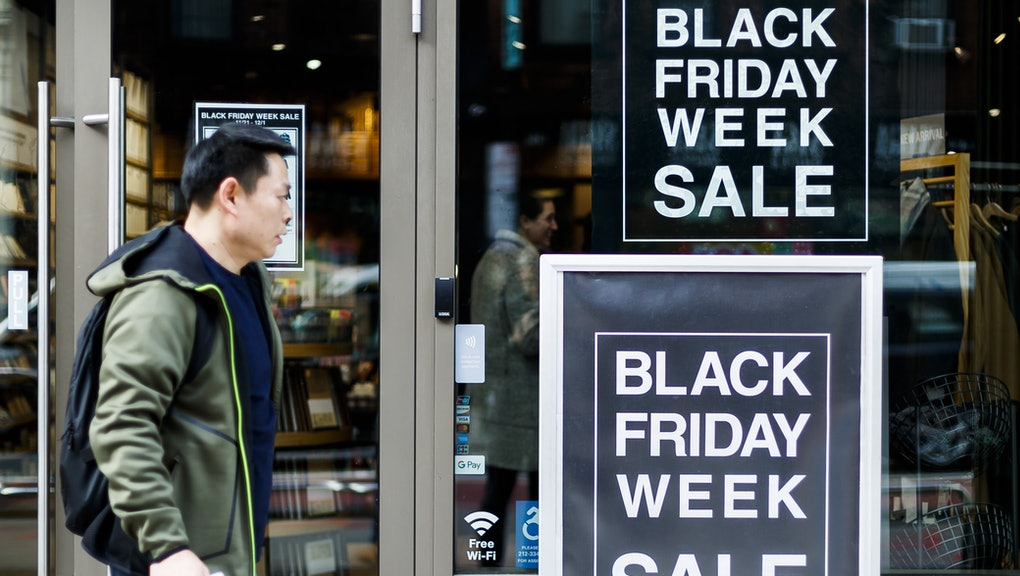 A person walks past signs for Black Friday related sales in New York, New York, USA, 25 November 2019. The annual sales on the Friday after the Thanksgiving holiday are traditionally seen as the start of the holiday shopping period.