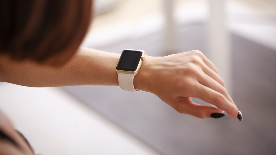 Woman using her smartwatch. Woman hand with smartwatch