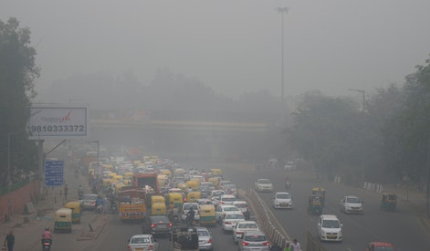 """Vehicles wait for a signal at a crossing as the city enveloped in smog in New Delhi, India. Authorities in New Delhi are restricting the use of private vehicles on the roads under an """"odd-even"""" scheme based on license plates to control vehicular pollution as the national capital continues to gasp under toxic smog"""