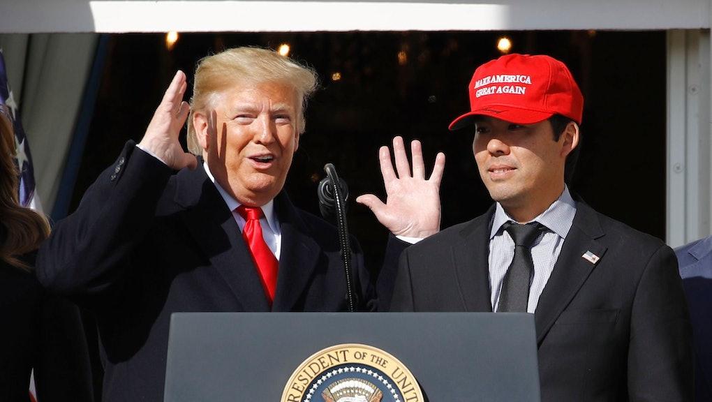 Donald Trump, Kurt Suzuki. President Donald Trump reacts as Washington Nationals catcher Kurt Suzuki walks to a podium to speak during an event to honor the 2019 World Series champion Nationals baseball team at the White House, in Washington
