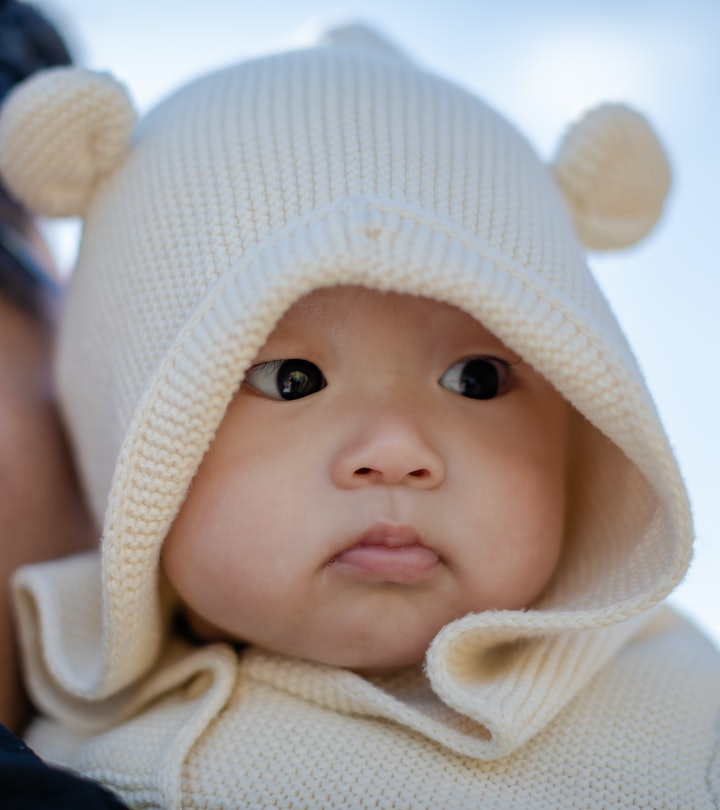 Portrait of adorable 4 months baby boy in the autumn season, outdoors