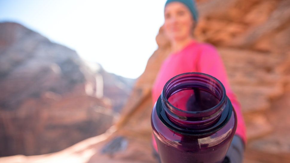 Purple Water Bottle Offer with extreme selective focus