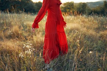 woman in summer dress walks in nature