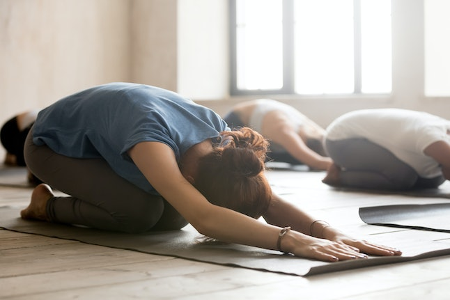 Experts say yoga can leave you feeling de-stressed, and can even make it easier to fall asleep at night.