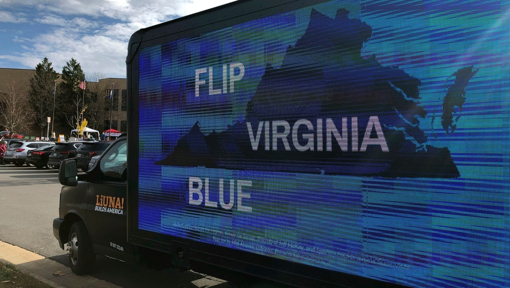 A mobile billboard urges voters to cast ballots for Democrats outside Centreville High School in Clifton, Va
