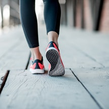 Sports woman in running shoes standing back on the wooden floor, close-up view focused on the sneakers. Exercise can help depression, but what if you're already depressed?