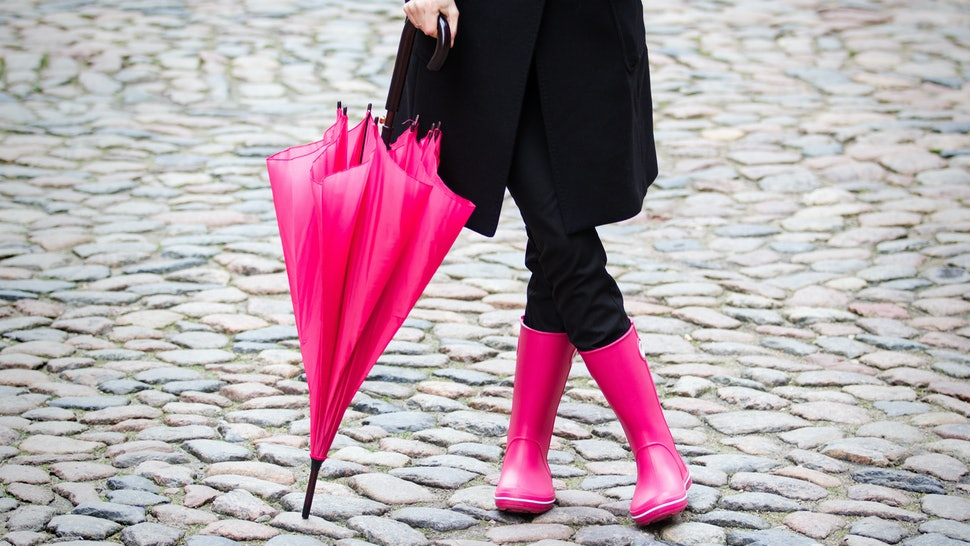 Woman with pink umbrella and pink rubber boots