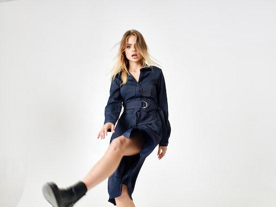 woman in dress steps street style fashion