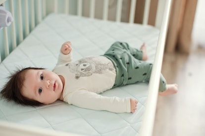baby lying in crib for his nap