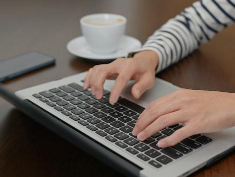 Woman type on laptop computer