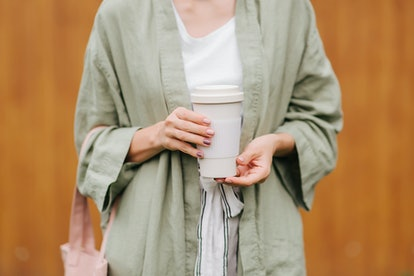 To thoroughly clean your reusable cup, use hot and soapy water, and consider adding a dash of bleach to effectively kill germs.