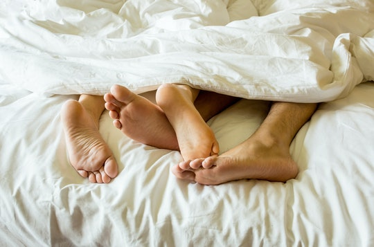 What happens to your vagina after sex? couple with feet entangled in bed
