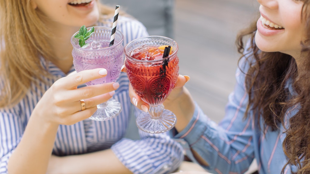Drinking may affect the periods of these two women clinking glasses very differently