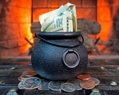 Halloween Cauldron Filled with Money by Fire