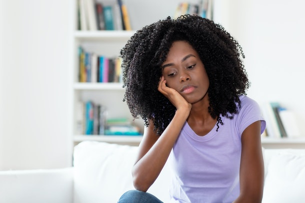 Sad and frustrated african american woman indoors at home