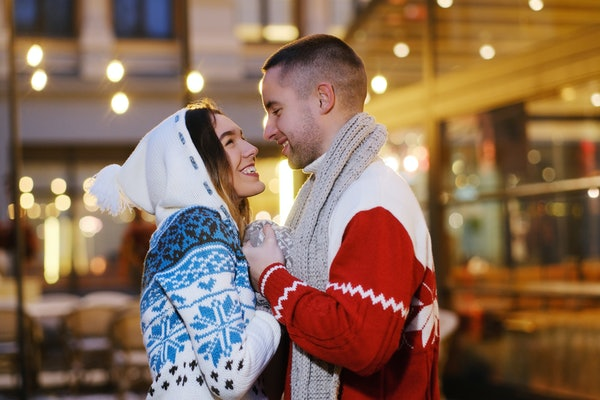 A happy couple has a holiday movie-inspired date night during Christmas.