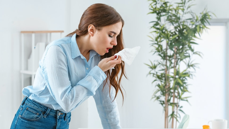 Woman ill with flu working in office