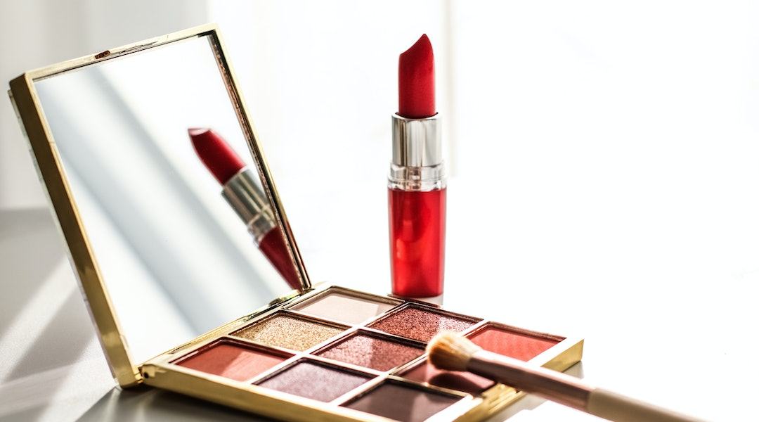 Cosmetic branding, girly and glamour concept - Cosmetics, makeup products set on marble vanity table, lipstick, eyeshadows and make-up brush for luxury beauty and fashion brand ads, holiday design