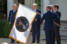 The flag of the United States Space Command is displayed during the ceremony where United States Pre...