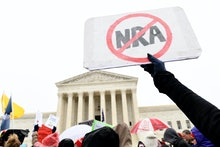 Gun protest, NRA. Protesters gather outside the Supreme Court in Washington, during arguments in the...