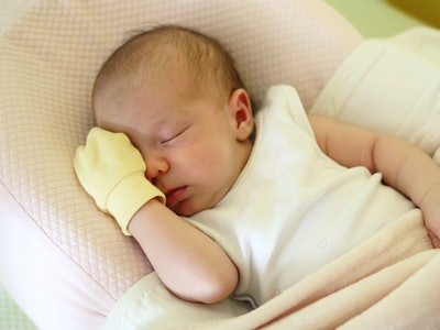 Experts explain that parents may consider their babies sleeping in mittens to prevent scratching.