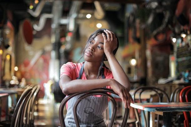 Tired waitress sitting