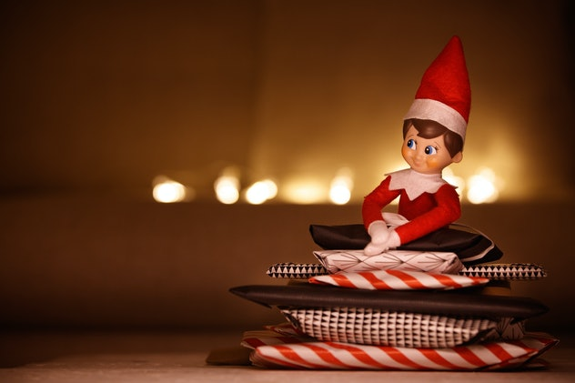 Funny Christmas toy dwarf with advent gifts. Holidays season.