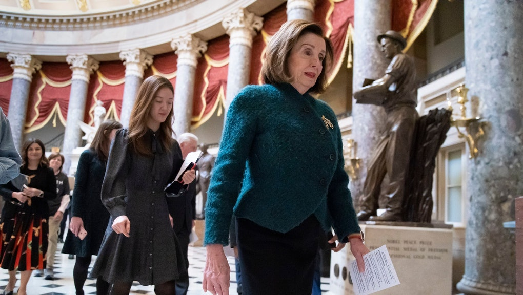 "Speaker of the House Nancy Pelosi, D-Calif., walks to attend a health care event at the Capitol in Washington,. House Democrats have announced two articles of impeachment against President Donald Trump, declaring he ""betrayed the nation"" with his actions toward Ukraine and obstruction of Congress' investigation"