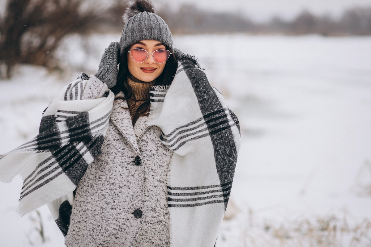 Young woman in a winter park