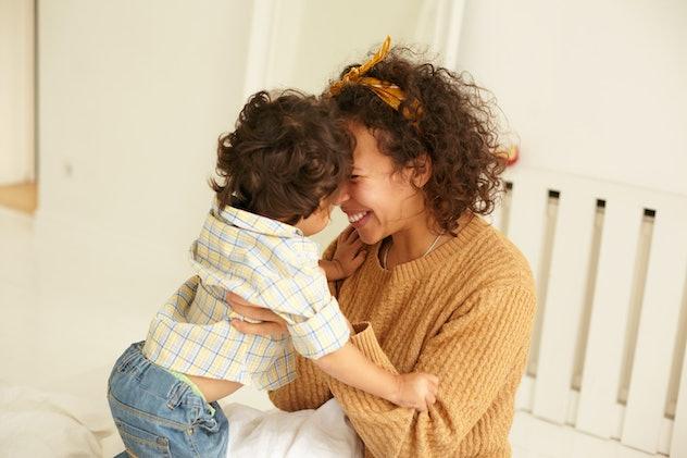 baby cuddling with mom