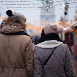 Lovely young couple on Christmas market