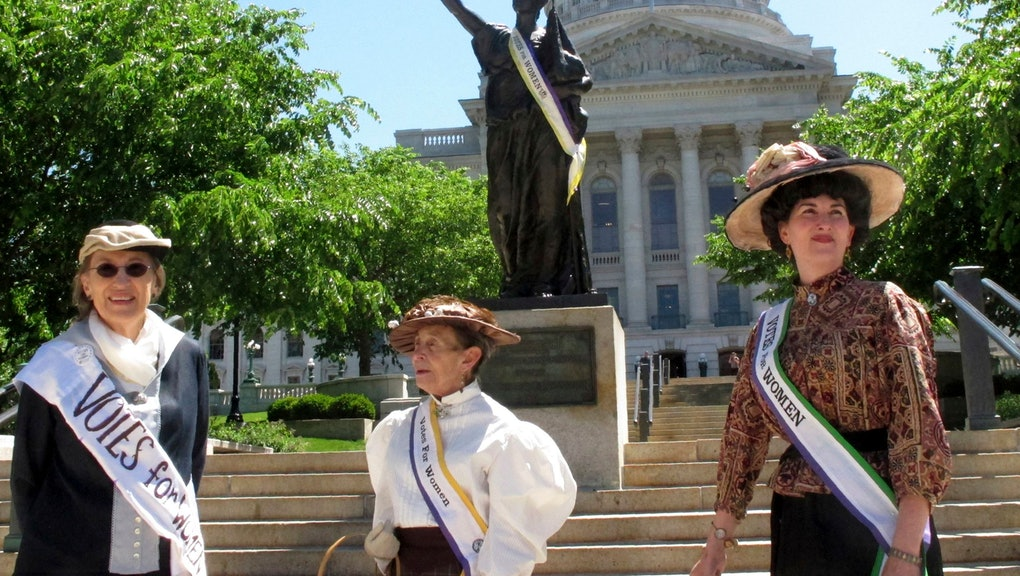 Women dressed in clothing styles from 1919 gather outside of the Wisconsin state Capitol on to commemorate the 100th anniversary of the state ratifying the 19th Amendment, which gave women the right to vote, in Madison, Wis. Wisconsin was the first state to ratify the amendment, which was ultimately added to the Constitution in 1920