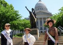 Women dressed in clothing styles from 1919 gather outside of the Wisconsin state Capitol on to comme...
