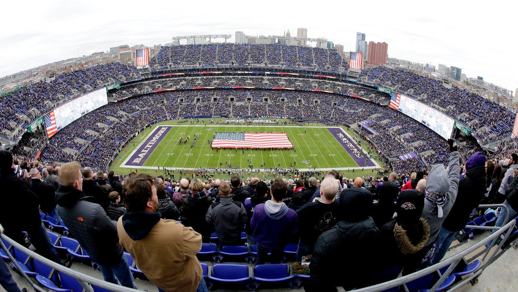 U.S. service members hold a large flag on the field at M&T Bank Stadium as part of the Baltimore Ravens' Salute to Service prior to an NFL football game against the Houston Texans, in Baltimore