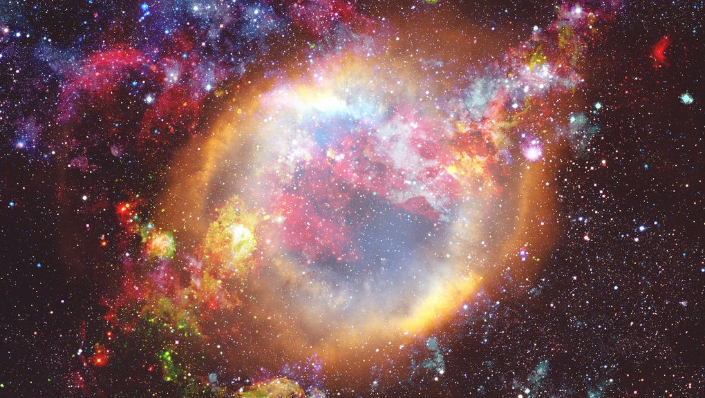 The explosion supernova. Bright Star Nebula. Distant galaxy. New Year fireworks. Abstract image. Elements of this image furnished by NASA.