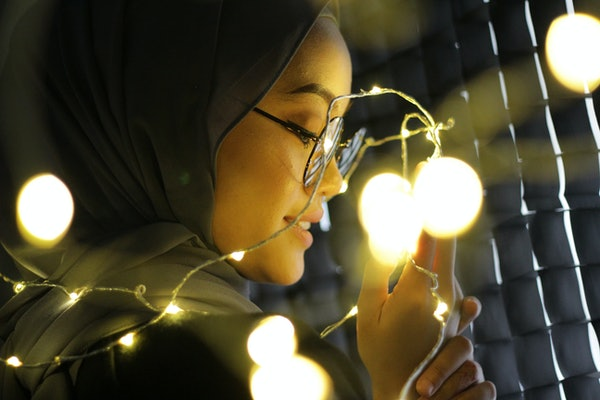 Portraiture of Asian women wearing hijab with fairy light concept.