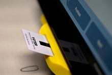 An electronic card with ballot information is seen inserted in a voting machine in Dallas, Ga. While...