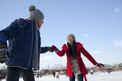 Young couple skating at ice rink. A great holiday activity